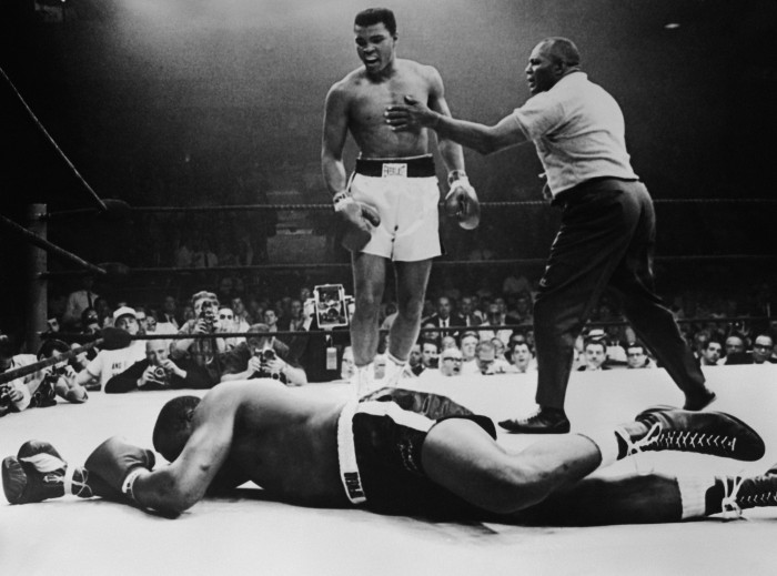 Sonny Liston lies out for the count after being KO'd in the first round of his return title fight by world heavyweight champion Muhammad Ali, Lewiston, Maine, May 25, 1965. (Photo by Hulton Archive/Getty Images)